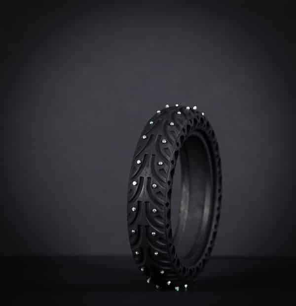 Honeycomb winter tire with nails in and black background