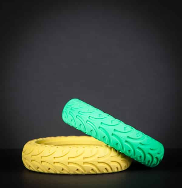 Yellow and green honeycomb tires with black background